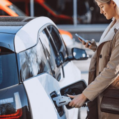 woman-charging-electro-car-electric-gas-station_1303-14685